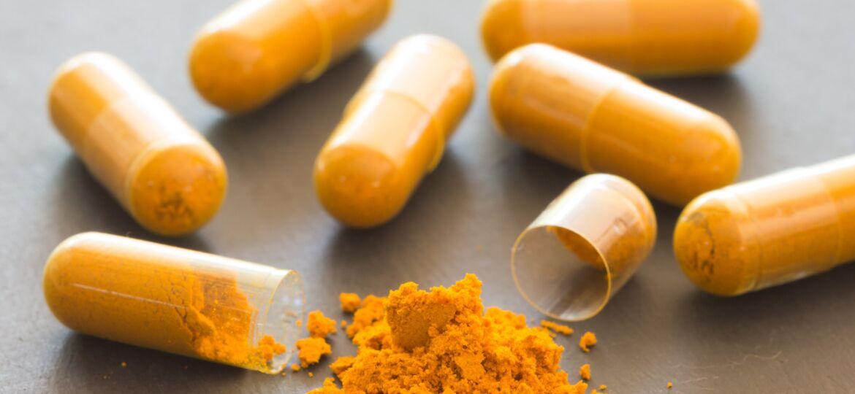 Turmeric powder  in tube and herbal Turmeric capsule